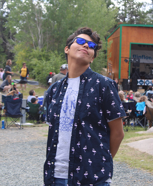 Lucas wearing sunglasses at a music festival