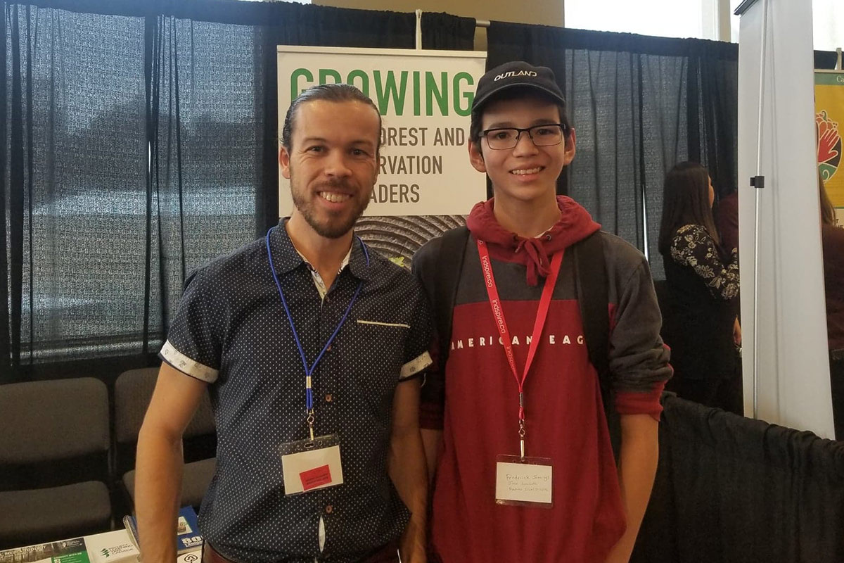 Paul stands with Fredering, a young Indigenous man and PLT Canada Green Jobs alumnus.