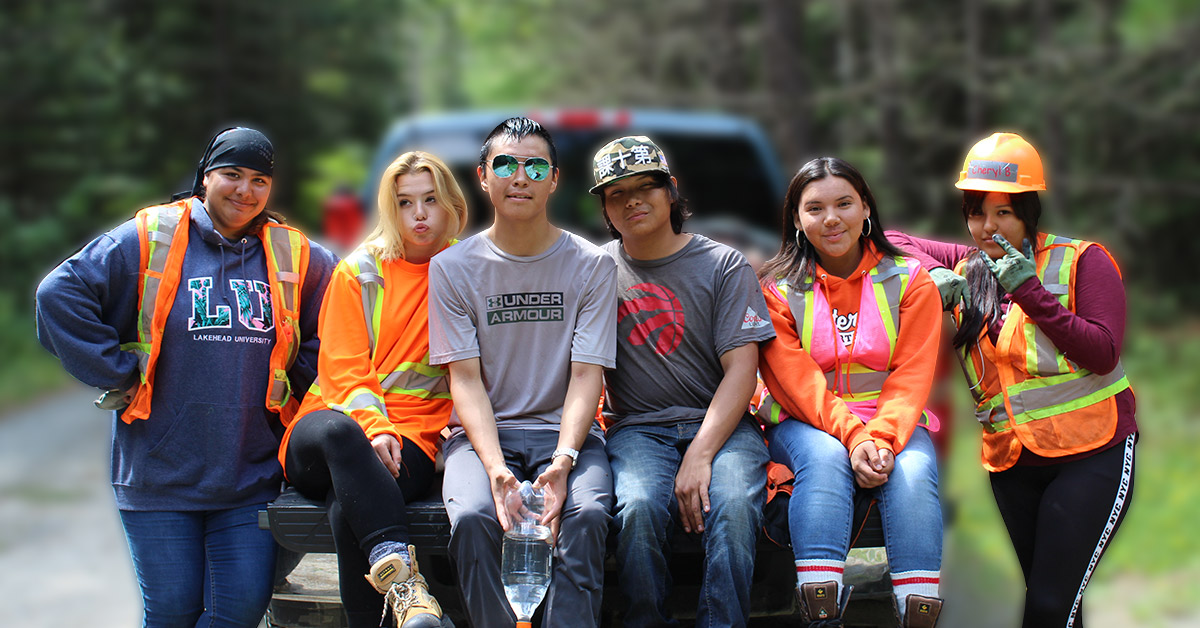 youth from Outland Youth Employment Program pose for a photo together on the back of a truck