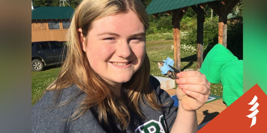 Nicole Boyde, an Education Assistant with the Chuntoh Education Society, banding a hummingbird, and helping teach ecological knowledge