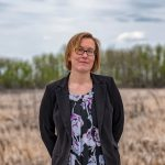 Bev Gingras standing in a field