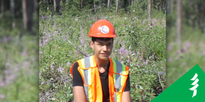 Photo of Gage in a hard hat and vest