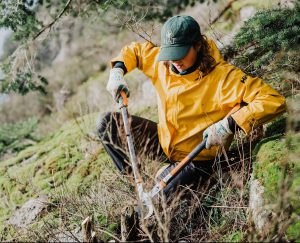 Photo of a conservation technician cutting twigs